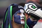 A pair of painted Seattle Seahawks fans watch the pre-season game against the Chicago Bears  at CenturyLink Field in Seattle, Washington on August 12, 2014.  Seattle beat Chicago 34-6. ©2014.  Jim Bryant Photo.