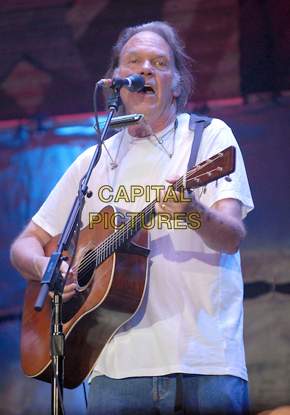 NEIL YOUNG.performs at the 2007 Farm Aid benefit concert that took place at Randalls Island, New York, New York, USA, 09 September 2007..half length gig concert live on stage music guitar.CAP/ADM/MO.©Moose/AdMedia/Capital Pictures.