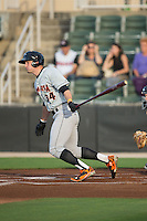 Conor Bierfeldt (34) of the Delmarva Shorebirds follows through on his swing against the Kannapolis Intimidators at CMC-Northeast Stadium on June 4, 2015 in Kannapolis, North Carolina.  The Shorebirds defeated the Intimidators 8-2.  (Brian Westerholt/Four Seam Images)