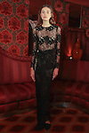 Model poses in an outfit from the Josie Natori Fall 2016 collection at the Doubles Club in the Sherry Netherland Hotel on February 10, 2016, during New York Fashion Week Fall 2016.