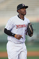 Kannapolis Intimidators right fielder Micker Adolfo (27) jogs off the field between innings of the game against the Delmarva Shorebirds at Kannapolis Intimidators Stadium on April 21, 2016 in Kannapolis, North Carolina.  The Intimidators defeated the Shorebirds 9-3.  (Brian Westerholt/Four Seam Images)
