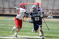 College Park, MD - April 8, 2017: Penn State Nittany Lions Tripp Traynor (33) avoids a Maryland Terrapins defender during game between Penn State and Maryland at  Capital One Field at Maryland Stadium in College Park, MD.  (Photo by Elliott Brown/Media Images International)