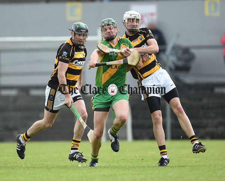Jacob Loughnane of O Callaghan's Mills in action against frank Mc Cormack and Conor Earley of Tubber during their match in Ennis. Photograph by John Kelly.