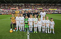 Children mascots with Per Mertesacker, Ashley Williams, referee Kevin Friend before the Barclays Premier League match between Swansea City and Arsenal at the Liberty Stadium, Swansea on October 31st 2015