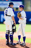 Catcher Josh Spano #21 of the High Point Panthers has a chat with pitcher Joe Goodman #33 during the game against the Dayton Flyers at Willard Stadium on February 26, 2012 in High Point, North Carolina.    (Brian Westerholt / Four Seam Images)