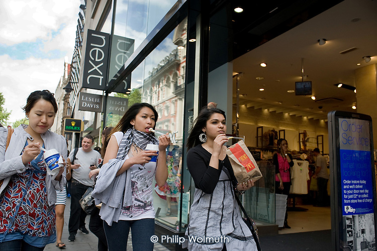 Shoppers and tourists in Oxford Street, London