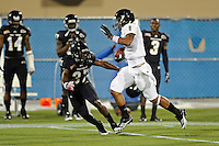 30 March 2012:  FIU's Loranzo Hammonds (8) evades Derrick Jones (37) while carrying the ball for a touchdown that was called back due to a penalty at the FIU Football Spring Game at University Park Stadium in Miami, Florida.