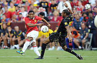 Manchester United midfielder Andreson (8) goes against FC Barcelona midfielder Seydou Keita (15)  Manchester United defeated Barcelona FC 2-1 at FedEx Field in Landover, MD Saturday July 30, 2011.