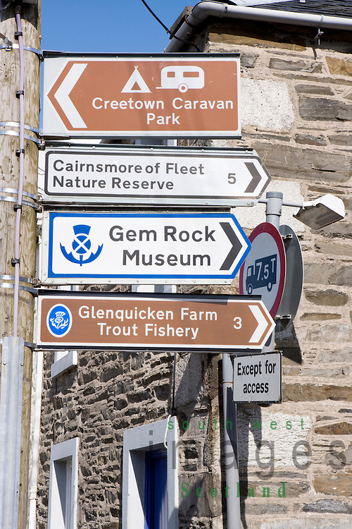 Road traffic signs on lap post pointing tourists to local visitor attractions in Creetown Galloway Scotland UK