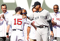 Derek Jeter #2 of the New York Yankees is greeted by Dustin Pedroia #15 of the Boston Red Sox after presenting him with second base during pregame ceremonies at Fenway Park in Jeter's final career game on September 27, 2014 in Boston, Massachusetts. (Photo by Jared Wickerham for the New York Daily News)