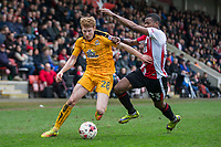 Brad Halliday of Cambridge United gets away from Liam Davis of Cheltenham Town during the Sky Bet League 2 match between Cheltenham Town and Cambridge United at the LCI Stadium, Cheltenham, England on 18 March 2017. Photo by Mark  Hawkins / PRiME Media Images.