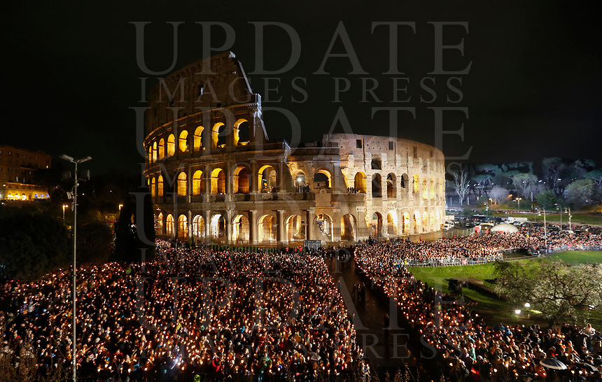 Faithful crowd the Colosseum on the occasion of the Via Crucis (Way of the Cross) on Good Friday, presided by the Pope in Rome, March 30, 2018.<br /> UPDATE IMAGES PRESS/Riccardo De Luca<br /> <br /> STRICTLY ONLY FOR EDITORIAL USE