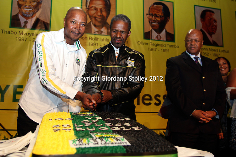 DURBAN - 23 April 2012 - Langa Dube (left), a grandson of African National Congress founding president John Dube, together with eThekwini regional chairman Sibongiseni Dhlomo cuts a slice of cake as Jeff radebe, the ANC's Deputy Chairman and South African Justice and Constitutional Development minister looks on at a gala dinner held at  International Convention Centre to commemorate the party's centenary..Picture: Giordano Stolley/Allied Picture Press/APP