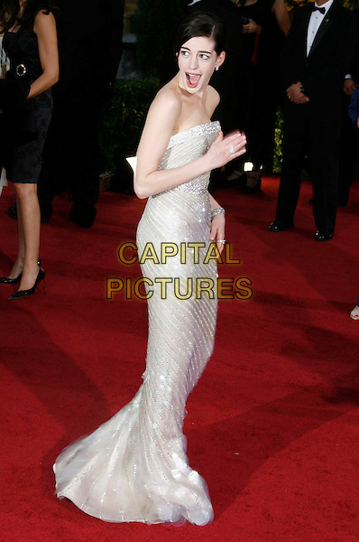 ANNE HATHAWAY.81st Annual Academy Awards held at the Kodak Theatre, Hollywood, California, USA..February 22nd, 2009.oscars full length long maxi silver cream beige beads beaded sequins sequined dress mouth open looking over shoulder funny face .CAP/ADM/MJ.©Michael Jade/AdMedia/Capital Pictures.