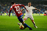 Real Madrid's player Lucas Vazquez and Sporting de Gijon's player Moi Gonzalez during match of La Liga between Real Madrid and Sporting de Gijon at Santiago Bernabeu Stadium in Madrid, Spain. November 26, 2016. (ALTERPHOTOS/BorjaB.Hojas)