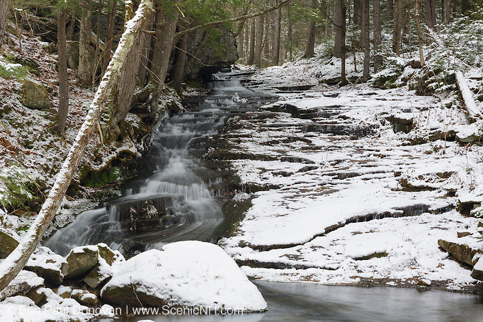 Dearth Brook Falls along Dearth Brook in Landaff, New Hampshire covered in snow during the winter months. This brook is located on the side of the Cobble Hill Trail.
