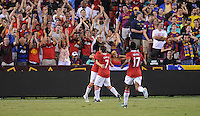 Manchester United forward Michael Owen (7) celebrates with teammates after scoring. Manchester United defeated Barcelona FC 2-1 at FedEx Field in Landover, MD Saturday July 30, 2011.
