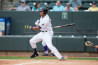 Keenyn Walker (24) of the Winston-Salem Dash follows through on his swing against the Myrtle Beach Pelicans at BB&T Ballpark on April 18, 2015 in Winston-Salem, North Carolina.  The Pelicans defeated the Dash 4-1 in game one of a double-header.  (Brian Westerholt/Four Seam Images)