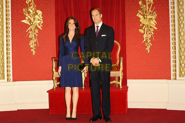 Madame Tussauds London reveals the new wax figures of Prince William and Kate Middleton aka Catherine, Duchess of Cambridge London, England..April 4th, 2012.waxwork full length blue dress black suit .CAP/CJ.©Chris Joseph/Capital Pictures.