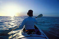 View from Back of Double Kayak, Paddling into Sun, Tobacco Caye, Belize.MR on file