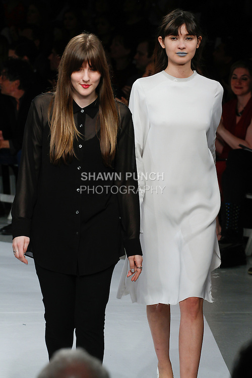 """Graduating fashion design student Lauren Sander, walks runway with model for the close of the 115th Annual Pratt Institute 2014 Student Runway; """"Under Construction"""" collection at Center548 in NYC, on May 1, 2014."""