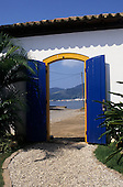 Paraty, Rio de Janeiro, Brazil. View through blue gates to the sea.