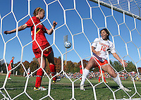 Virginia's Morgan Ruether (18) reacts after Maryland's  Natasha Ntone-Kouo (18) tries to kick the ball out of the goal during the first round of the ACC Tournament against Maryland Sunday at Klockner Stadium.  Virginia defeated Maryland 6-1. Photo/The Daily Progress/Andrew Shurtleff