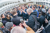 Architect Santiago Calatrava, center, speaks to the media in the partially finished World Trade Center Transportation Hub, known as the Oculus, opens to the public on Thursday, March 3, 2016. The over-budget, years late, $4 billion state-of-the-art transportation hub was designed by Calatrava. When finished the hub will connect subway lines and PATH trains. (© Richard B. Levine)