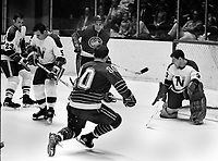 California Seals vs North Stars...1969 photo, Seals Ted Hampson and Gary Jarrett90. Northstars Leo Boivin and goalie Fern Rivard. (photo/Ron Riesterer)