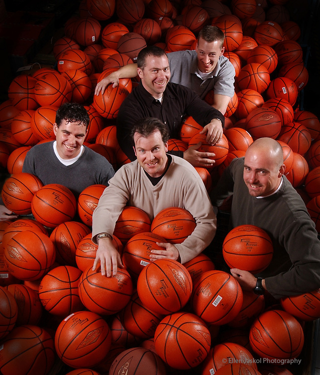 The Product Development team at Classic Sports with some of their product. They also sell classic games like air hockey and will be selling the Old School Ball Park.  Left to rt, front row:   Tom Doherty, Mike Oister, and Matt Torson.  center: Clancey Boettcher, and far back is Chris Wisener.