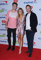 01 December  2017 - Inglewood, California - Dean Unglert, Becca Tilley, Chris Harrison. 2017 102.7 KIIS FM's Jingle Ball held at The Forum in Inglewood. Photo Credit: Birdie Thompson/AdMedia
