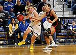 BROOKINGS, SD - FEBRUARY 8: Tagyn Larson #24 of the South Dakota State Jackrabbits drives to the basket past Josie Filer #25 of the Omaha Mavericks at Frost Arena February 8, 2020 in Brookings, South Dakota. (Photo by Dave Eggen/Inertia)