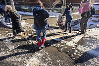 Pedestrians maneuver through puddles of slush and snow at a street crossing in the Chelsea neighborhood of New York on Friday, February 14, 2013. 9.5 inches of snow fell on the city from midnight to 1PM on Thursday with a few more inches forecast after midnight into Friday.(© Richard B. Levine)