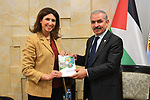 Palestinian Prime Minister Mohammad Ishtayeh receives the annual report of the Palestinian Central Bureau of Statistics for the year 2018, in the West Bank city of Ramallah, April 17, 2019. Photo by Prime Minister Office