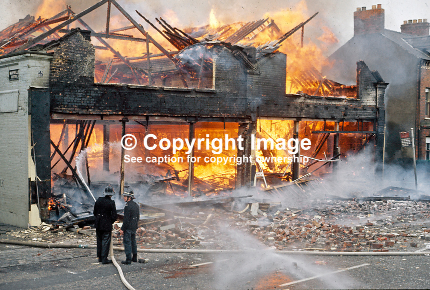 IRA explosion followed by a fire at Smyth &amp; McClure's supermarket, Lisburn Road, Belfast, N Ireland. Firemen hose down the flames. 197303080043.<br />