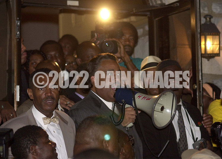 Rev. Al Sharpton, center, with bullhorn,  speaks at a protest of the July 12 beating of Thomas Jones by city police officers attempting to arrest the carjacking suspect, Sunday, July 23, 2000, in Philadelphia. The beating incident was videotaped by a local television station helicopter, and broadcast around the world, shedding a bad light on the city of Philadelphia two weeks before the Republican National Convention. (Photo by William Thomas Cain/Newsmakers)