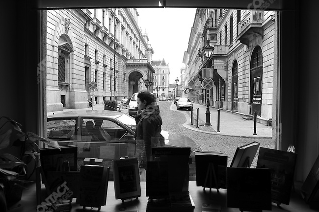 A woman walked past a bookstore and cafe near the Opera House in Budapest, Hungary, March 24, 2008