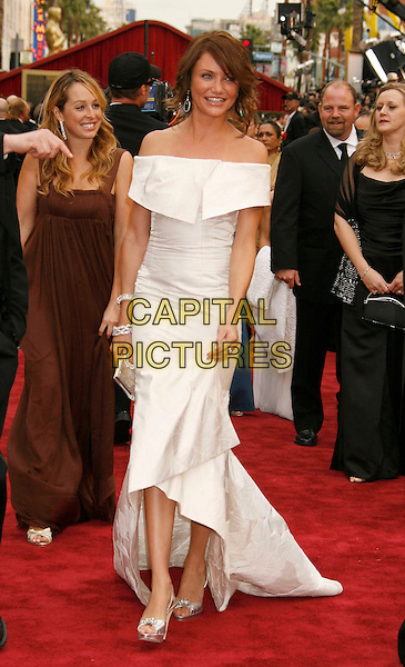 CAMERON DIAZ.The 79th Annual Academy Awards - Arrivals held at the Kodak Theatre, Hollywood, California, USA,.25 February 2007..oscars red carpet full length white off the shulder dress green dangly earrings ring bracelet jewellery silver strappy shoes sandals .CAP/ADM/RE.©Russ Elliot/AdMedia/Capital Pictures.