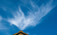 Cirrus clouds high in the sky.