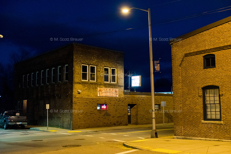 Cardosa Cafe on Montello Street is one of few businesses open at night near downtown Brockton, Massachusetts, USA, on Wed., March 29, 2017.