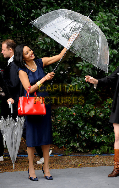 Shakira Caine.UK Premiere of 'Cars 2' at Whitehall Gardens, London, England..July 17th 2011.full length blue dress red bag purse umbrella .CAP/WIZ.© Wizard/Capital Pictures.