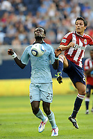 Sporting KC midfielder Kei Kamara (23) controls the ball despite the challenge of Chivas USA defender Zarek Valentin... Sporting KC and Chivas USA played to a 1-1 tie at LIVESTRONG Sporting Park, Kansas City, Kansas.
