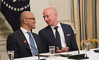 Microsoft CEO Satya Narayana (left) and Amazon CEO Jeff Bezos (right) chat during an American Technology Council roundtable with corporate and eduction leaders at The White House in Washington, DC, June 19, 2017. <br /> Credit: Chris Kleponis / CNP /MediaPunch
