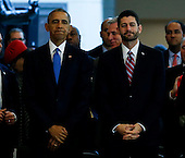 United States President Barack Obama, stands next to Speaker of the House Paul Ryan (Republican of Wisconsin), right, at an event commemorating the 150th anniversary of the 13th Amendment, which formally abolish slavery, on Capitol Hill, in Washington, DC, December 9, 2015.  <br /> Credit: Aude Guerrucci / Pool via CNP