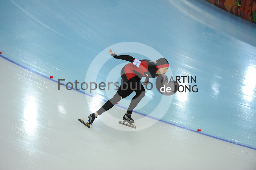 OLYMPICS: SOCHI: Adler Arena, 13-02-2014, 1000m Ladies, Beixing Wang (CHN), ©foto Martin de Jong