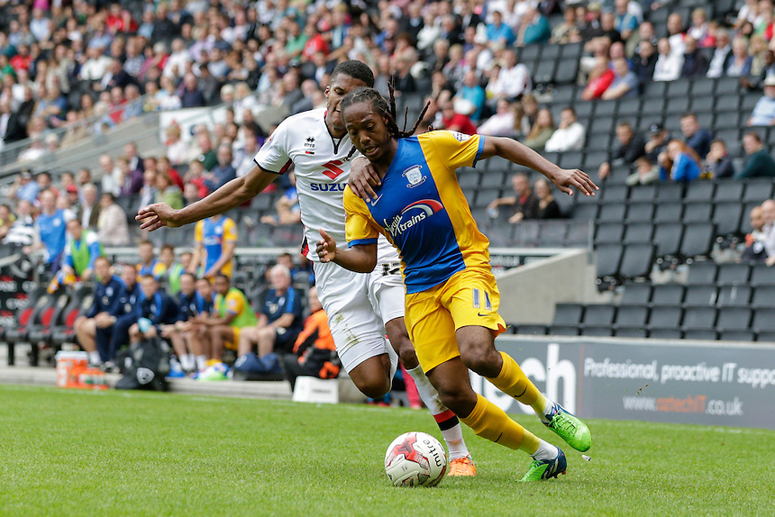 Preston North End's Daniel Johnson holds off the challenge from Milton Keynes Dons' Jordan Spence<br /> <br /> Photographer Craig Mercer/CameraSport<br /> <br /> Football - The Football League Sky Bet Championship - Milton Keynes Dons v Preston North End - Saturday 15th August 2015 - Stadium:mk - Milton Keynes<br /> <br /> &copy; CameraSport - 43 Linden Ave. Countesthorpe. Leicester. England. LE8 5PG - Tel: +44 (0) 116 277 4147 - admin@camerasport.com - www.camerasport.com