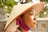 VIETNAM, Hanoi, portrait of a young woman wearing a non la or leaf hat, Hoan Kiem Lake