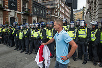 Around 10,000 supporters of far right activist Tommy Robinson gather in Whitehall to demand his release after he was jailed for contempt of court. A small number confronted a counter protest by anti racist groups. Others attacked police and briefly drove them into a side street away from trafalgar square. 9-6-18