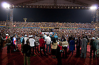 Rwandan president Paul Kagame (in middle with blue jacket and blue cap), his family and supporters wait for him to make a speech after the announcment of partial presidential election results at Amahoro stadium, Kigali, Rwanda. President Paul Kagame won 93 percent of the counted votes.  August 10 2010