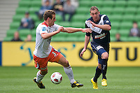 MELBOURNE, AUSTRALIA - SEPTEMBER 12, 2010: Luke DeVere from the Roar competes for the ball against Geoff Kellaway from the Victory in Round 6 of the 2010 A-League between the Melbourne Victory and Brisbane Roar at AAMI Park on September 12, 2010 in Melbourne, Australia. (Photo by Sydney Low / Asterisk Images)